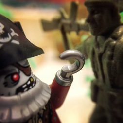 As the Dirt Cheap Suicide Squad and the undead crew of the pirate ship Wastrel meet outside the entrance of the Savage Arena, tempers flare. Harsh words are exchanged, among them 'Arrr!' and 'Oorah!'