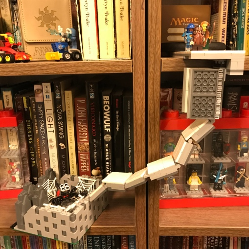 The only way I could display this was on my bookshelf :D The party on the upper level is about to fall into the trap and slide down the chute.