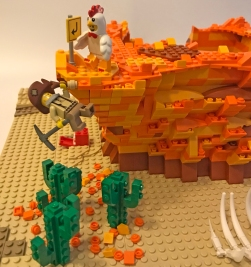 In this scene, the Chicken has tricked the Prospector into stepping off a cliff, and now he's dangling by a root. It doesn't look like a soft landing below ...