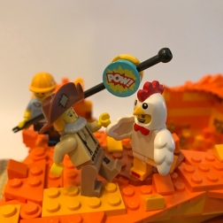 Zeke the Sound Guy provides helpful sound effects to a tussle between the Prospector and the Chicken.