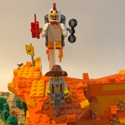 The Prospector isn't the only one who can take advantage of the Zenith Corporation's mail-order service! Here's the Chicken wearing a specially modified Rocket-Powered Backpack, complete with robot arms to drop dynamite and dumbbells on unsuspecting foes below! The Prospector doesn't stand a chance!